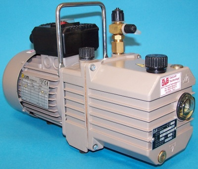 Refrigeration and Air Conditioning vacuum pump with refrigeration fitting attached.